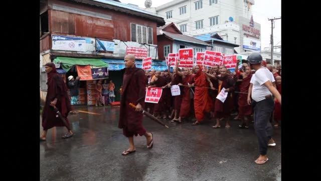 Myanmars bitterly divided Rakhine State saw mass protests Sunday as thousands of Buddhists including monks demonstrated in a show of opposition to a...