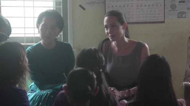 Myanmar's opposition leader Aung San Suu Kyi and US actress and UN High Commissioner for Refugees Goodwill Ambassador Angelina Jolie meet with female...