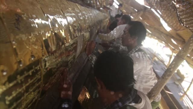 myanmars shwedagon pagoda has received record donations of gold from members of the public this year is being re gilded in spectacular to a bumper... - bumper stock videos & royalty-free footage