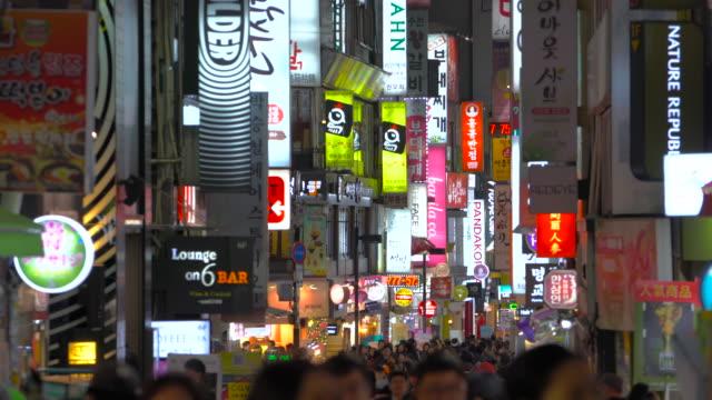 myeongdong market in central seoul south korea - ソウル点の映像素材/bロール