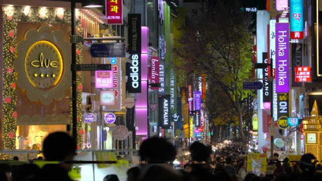 stockvideo's en b-roll-footage met myeongdong market in central seoul south korea - winkelbord