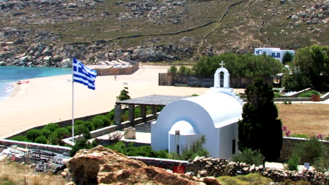mykonos shore  with a flag of greece - mykonos stock videos & royalty-free footage