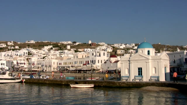 mykonos town, greece, with harbour, church and mediterranean sea - mykonos stock videos and b-roll footage
