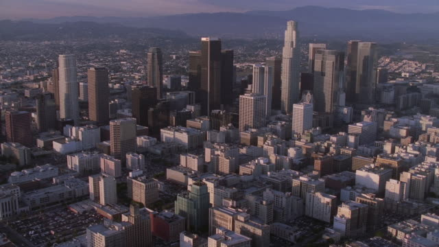 aerial myriad of buildings and skyscrapers in downtown los angeles / california, united states - 20世紀のスタイル点の映像素材/bロール