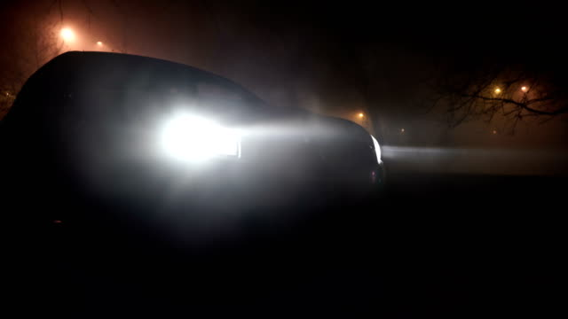 mysterious car in the woods, horror scene - headlight stock videos & royalty-free footage