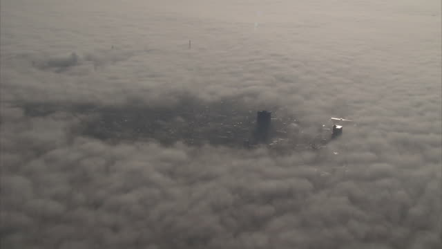 mysterious fog covering a modern city. - covering stock videos and b-roll footage