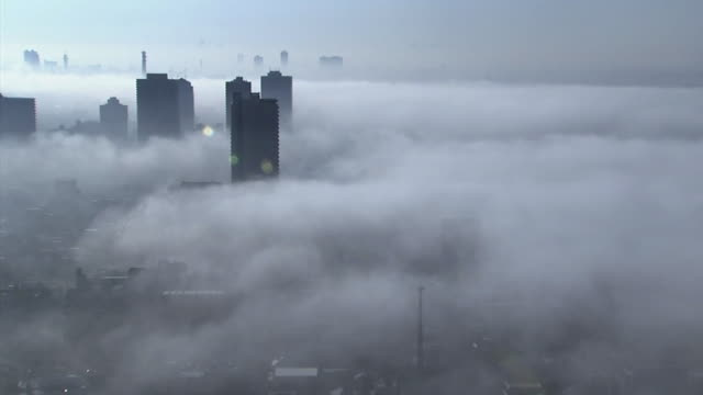 Mysterious fog covering a modern city.