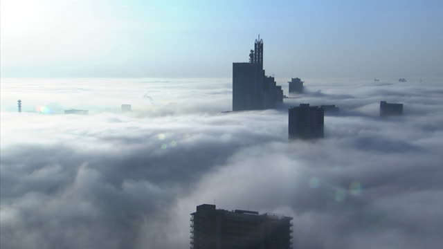 mysterious fog covering a modern city. - saitama city stock videos & royalty-free footage