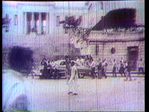 mysterious illness 1959 bw ms people on street during communist revolution lms ditto ms ditto ms placard held by demonstrators cms fidel castro along... - fidel castro stock videos and b-roll footage