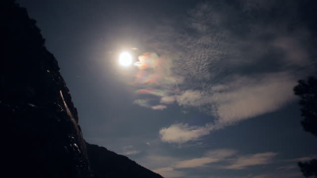 mysterious landscape. trees and mountains sihouettes with glowing moon - halo stock videos and b-roll footage