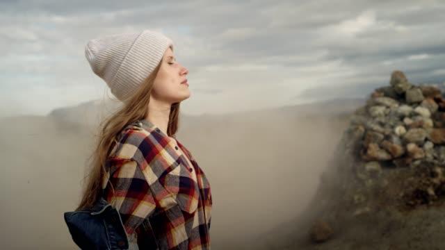 mysterious landscape. woman enjoying warm steam - scena non urbana video stock e b–roll