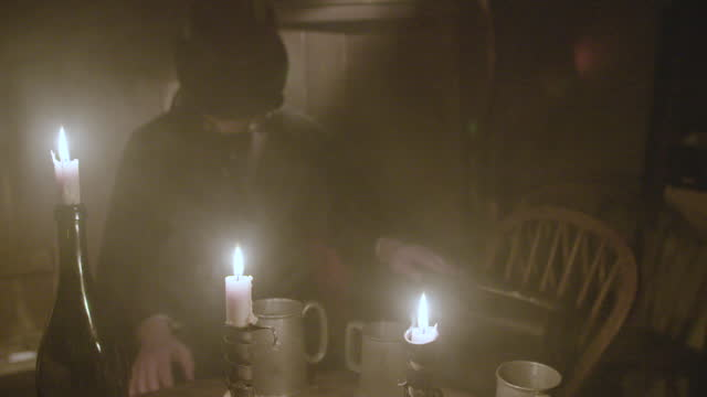 mysterious man in top hat and cape sits by candle with head down, holding a bag - late 1800s jack the ripper reenactment . - top hat stock videos & royalty-free footage
