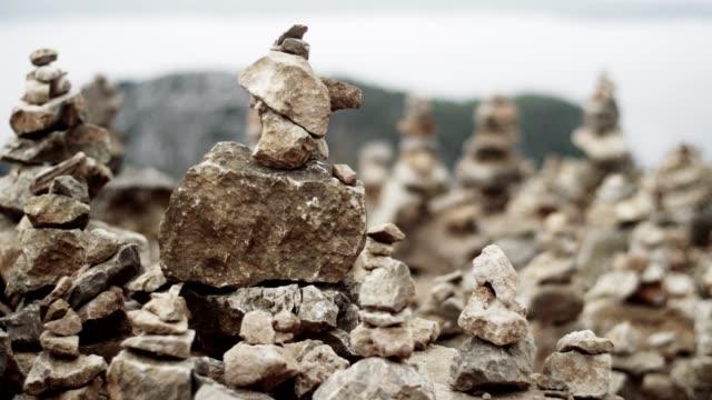 mysterious stone towers on a rocky coastline - mythology stock videos & royalty-free footage