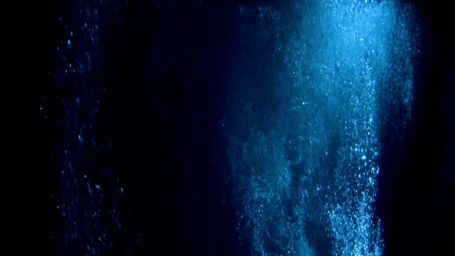mysterious underwater scenery with bubbles - deep stock videos & royalty-free footage