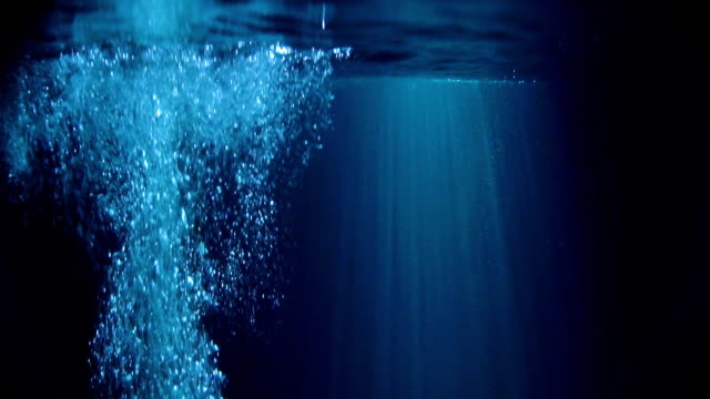 Mysterious underwater scenery with bubbles