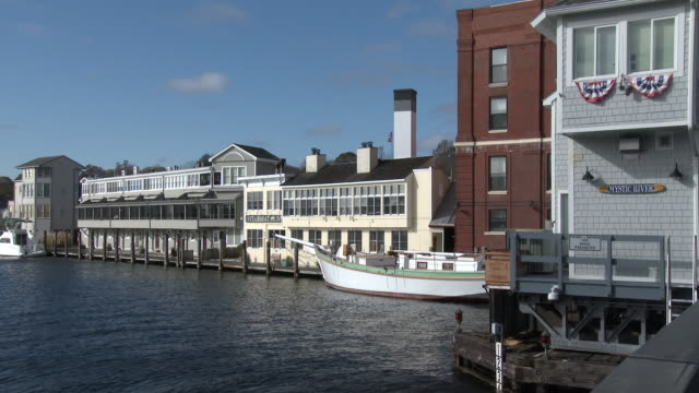 mystic river - waterfront businesses and residential buildings - new london county connecticut stock videos & royalty-free footage