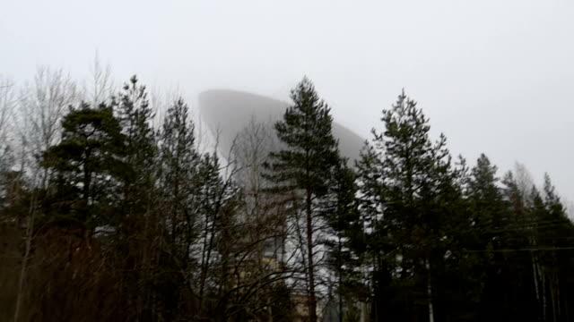 Mystical huge radio telescope in the fog