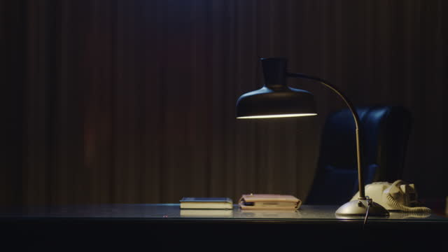 mystical night scene of a lamp on a desk - electric lamp stock videos & royalty-free footage