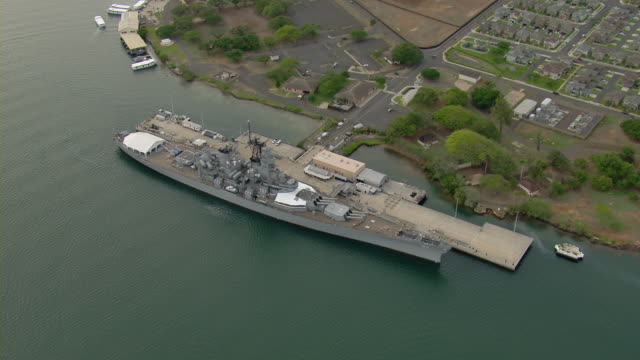 \n aerial of battleship missouri memorial on ford island in pearl harbor, hawaii. - pearl harbor stock videos and b-roll footage