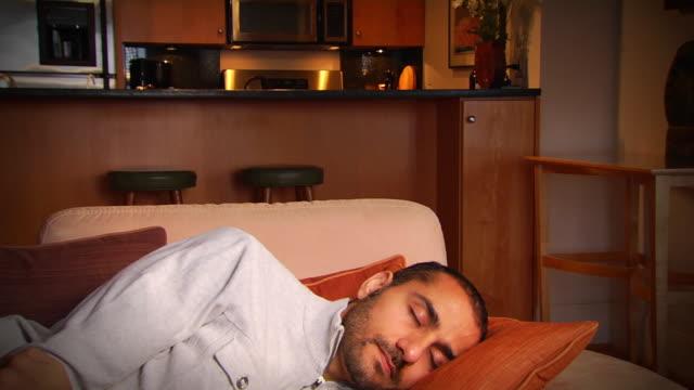 nabil sleeps - jib down 1 - sofa stock videos & royalty-free footage