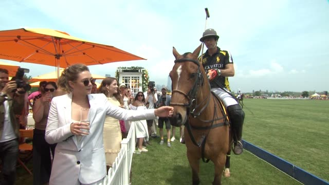 Nacho Figuera Elizabeth Olsen at NinthAnnual Veuve Clicquot Polo Classic at Liberty State Park on June 4 2016 in Jersey City New Jersey