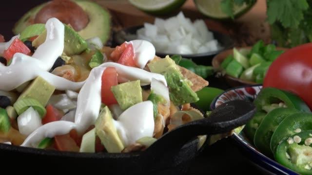 nachos closeup - sour cream stock videos and b-roll footage