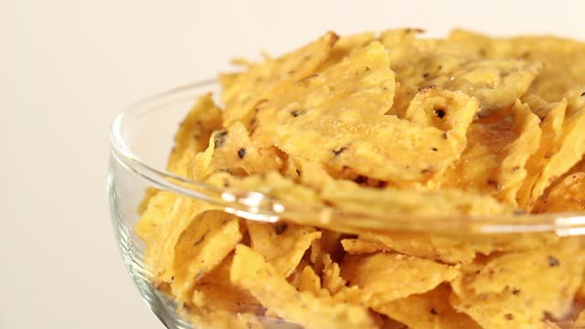 nachos rotating on white - salty snack stock videos & royalty-free footage