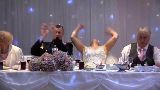 vidéos et rushes de nadine hanlon celebrating england's victory against sweden at her reception in doncaster after she renewed her vows with husband lee - bride