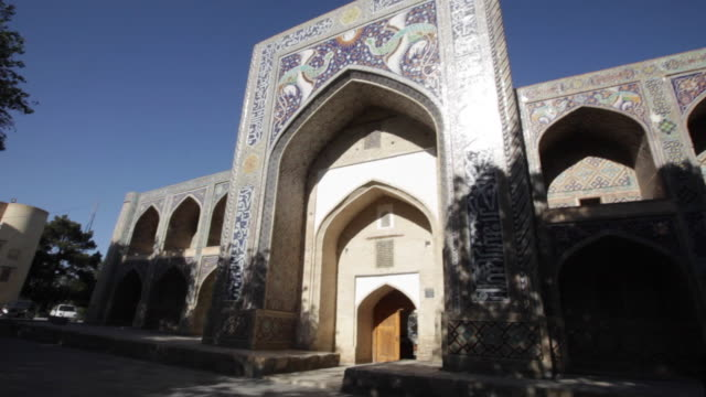 nadir divan-beghi madrassah, lyab-i hauz ensemble, bukhara, uzbekistan - bukhara stock videos and b-roll footage