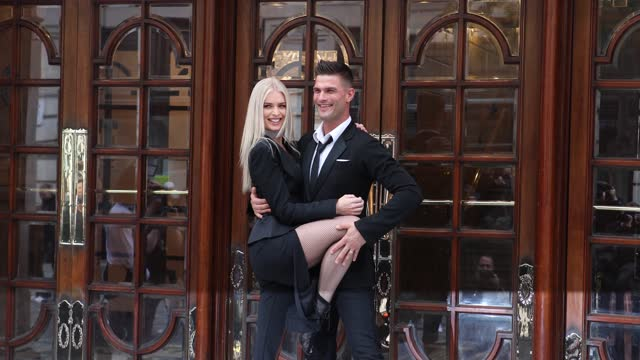 "nadiya bychkova and aljaž škorjanec pose during the ""here come the boys"" photocall at london palladium on may 25, 2021 in london, england. - イングランド南東部点の映像素材/bロール"