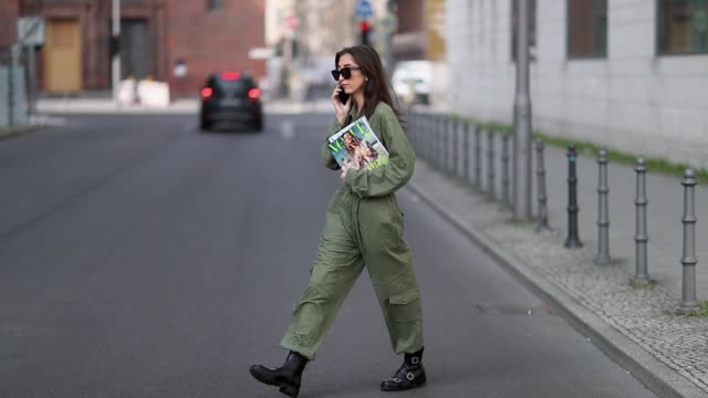 nadja ali is seen holding a vogue magazine wearing a green jumpsuit by lala berlin jimmy choo boots and celine sunglasses on april 5 2019 in berlin... - jumpsuit stock videos & royalty-free footage