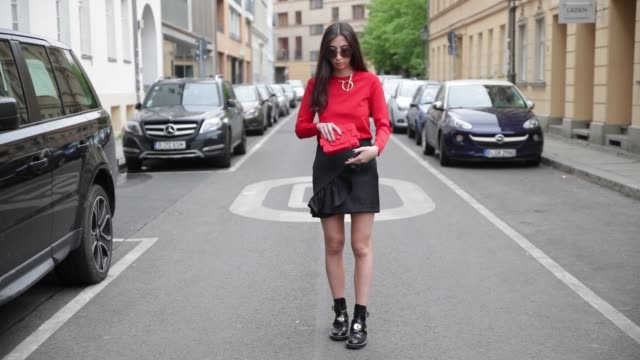 nadja ali wearing a red balenciaga sweater sabrina dehoff necklace black hm skirt black balenciaga boots red chanel clutch fendi sunglasses on may 7... - necklace stock videos & royalty-free footage