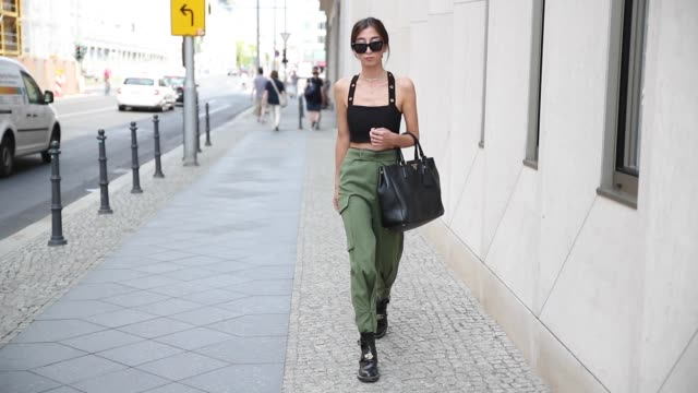 Nadja Ali wearing olive green military pants Lala Berlin cropped Topshop top Balenciaga boots Prada bag on August 2 2018 in Berlin Germany