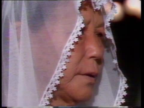 nagasaki bomb anniversary:; b) japan: nagasaki: catholic cathedral: int gv catholic church ceremony - women wearing white veils older woman wearing... - anniversary stock videos & royalty-free footage