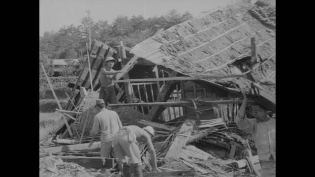 vidéos et rushes de nagasaki survivors work to rebuild bomb blasted homes - 1945
