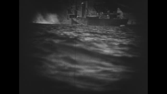 vs pov of nagasaki through the viewfinder of a periscope and scan of a japanese camouflaged coal ship and colliery a good view of a torpedo hitting... - mine stock videos & royalty-free footage