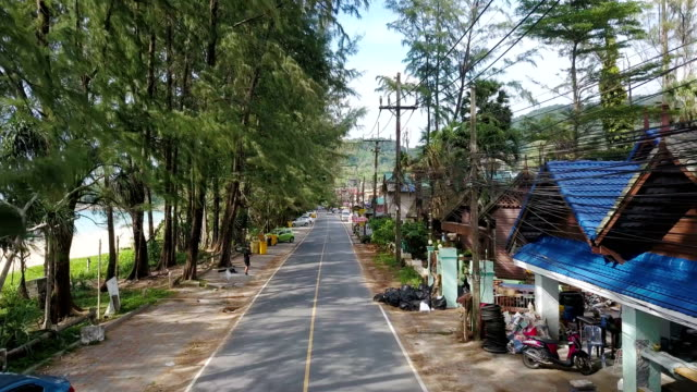 nai thon beach road aerial view - phuket stock videos & royalty-free footage