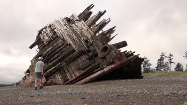 Naikoon Provincial Park Pestua shipwreck beach hiker man Haida Gwaii British Columbia Canada