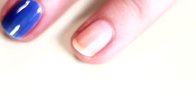 hd: nail polish on long woman nails - blue - sexual fetish stock videos and b-roll footage