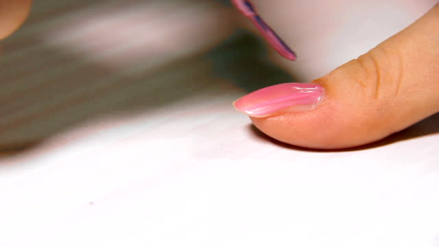 hd: nail polish on long woman nails - pink - sexual fetish stock videos & royalty-free footage