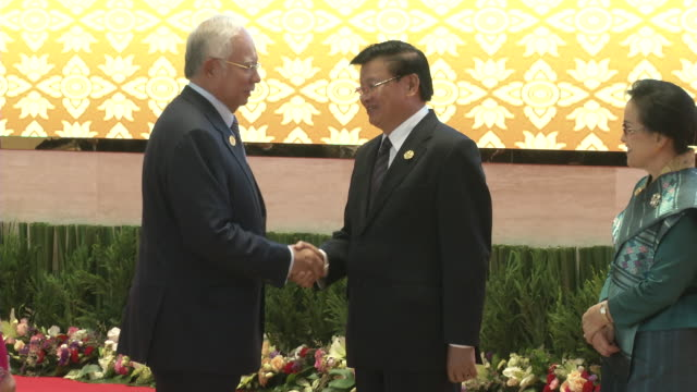 najib razak and wife are greeted by the laos prime minister thongloun sisoulith and wife at the association of southeast asian nations summit the... - association of southeast asian nations stock videos & royalty-free footage