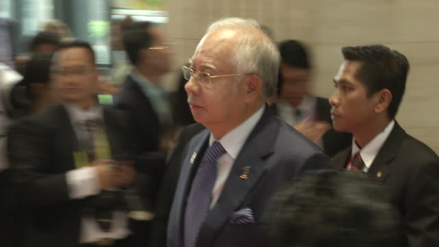 najib razak pm of malaysia walks to a meeting during the association of southeast asian nations summit the laotian capital vientiane - association of southeast asian nations stock videos & royalty-free footage