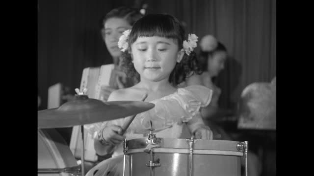 VS Nakagawa Troupers Japanese children's band performing for wounded UN Korean War soldiers at the Butterfly Club in Tokyo young girl plays...