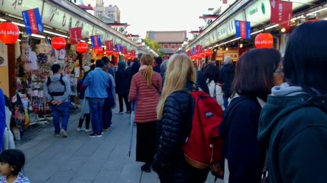 nakamise-dori street and hozomon gate in night , asakusa , japan . - souvenir stock videos & royalty-free footage