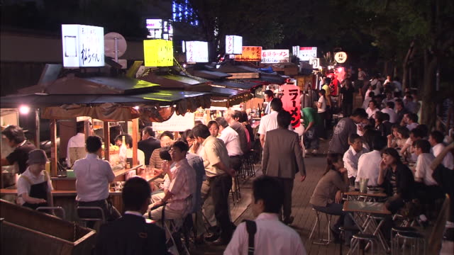 """nakasu-the largest """"yatai"""" district in western japan embodies the local food spirit. at night, many stalls are set up along nakasu river to welcome... - fukuoka prefecture stock videos & royalty-free footage"""