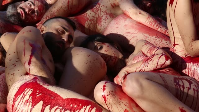 Naked activists of the animalrights group 'AnimaNaturalis' covered with fake blood stage a protest to denounce the use of animal skins in Barcelona...