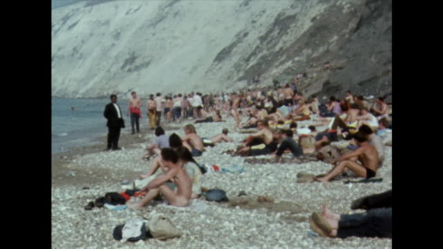 naked hippies skinny dip on isle of wight beach; 1970 - the past stock videos & royalty-free footage