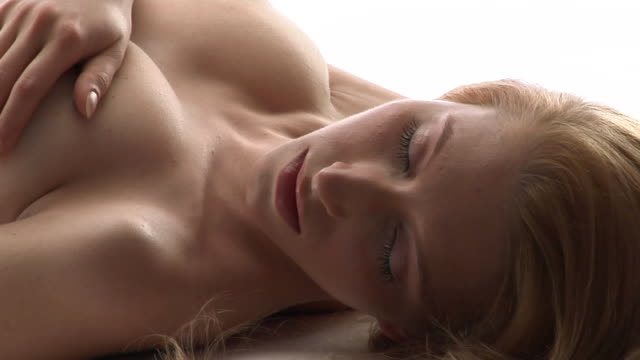 cu, pan, naked woman lying in studio - blonde hair stock videos & royalty-free footage