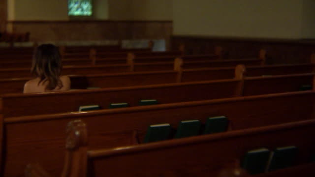 naked woman sits in church pews - paranormal stock videos & royalty-free footage