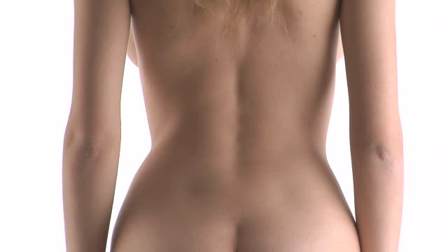 vídeos de stock, filmes e b-roll de cu, tu, naked woman stretching arms in studio, rear view - membro parte do corpo